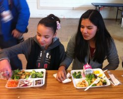 Students at Marston Middle School in Clairemont enjoy locally grown broccoli for their school lunch on Monday.