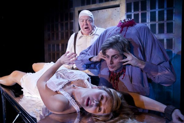 "Rachel Avery as Megan, Jesse Merlin as Dr. Hill, and George Wendt as Dean Halsey in ""Re-Animator: The Musical."""