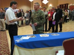 Master Gunnery Sergeant Damon Bitts, speaking to the recruiter for Lockheed Martin at the Military.com Jobs Fair, March 8th 2011.