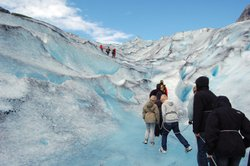 Rick Steves with a group of people hiking a glacier in Norway