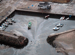 This aerial shot shows boats being carried away at a flooded marina in Hitach...