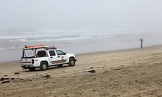 Lifeguards patrolled the beach as they always d...