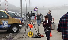 Local media gathered along the beach to capture...
