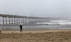 Surfers in Ocean Beach continued to ride the wa...