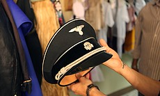 The hat worn by the Emcee is a vintage SS hat, with the insignia of the Schut...