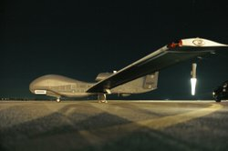 An RQ-4 Global Hawk sits on the runway before beginning a nighttime mission. ...