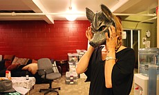 "Karson St. John tries the wolf mask she'll wear during ""Cabaret."""