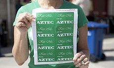 This woman handed out stickers celebrating both the Aztecs and St. Patrick's Day.