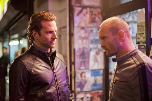 "Bradley Cooper with Andrew Howard in ""Limitless."""