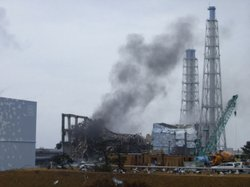 Gray smoke rises from Unit 3 of the tsunami-stricken Fukushima Dai-ichi nucle...