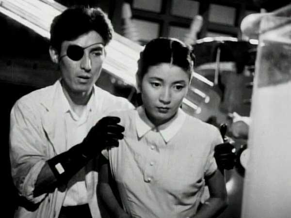 "Akihiko Hirata as Dr. Serizawa and Momoko Kôchi as Emiko in 1954's ""Godzilla,"" the film was released as a badly recut and badly dubbed American version known as ""Godzilla, King of the Monsters."""
