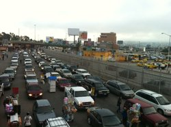 Dozens of cars line up in Tijuana waiting to be examined by Customs as they e...