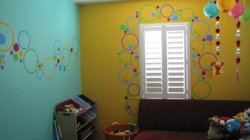 Danica Tapia decorated the playroom for her son's first birthday. She hand pa...