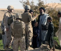 Marines from 9th Engineer Support Battalion, 1st Marine Logistics Group, talk...