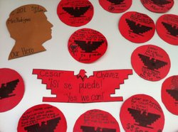 A tribute to Cesar Chavez featuring messages that students wrote hang on a cl...