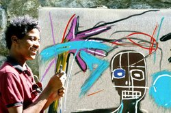 Jean-Michel Basquiat painting a canvas.