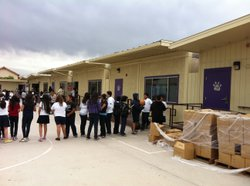 School children at Jefferson Elementary file into makeshift classrooms while ...