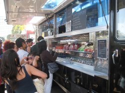 Customers wait to make their orders at a food truck in Los Angeles.  What's f...