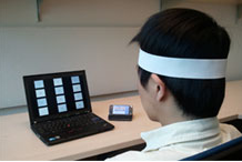 A student tests a new brain-wave cell phone app.