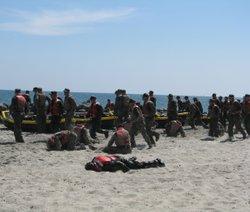 Navy SEALS train on the beach in this undated photo.