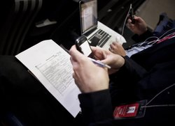 A copy of President Barack Obama's long form birth certificate sits on a reporter's lap while he works on his Blackberry in the Briefing Room of the White House April 27, 2011 in Washington, DC.
