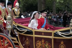Their Royal Highnesses Prince William, Duke of Cambridge and Catherine, Duchess of Cambridge make the journey by carriage procession to Buckingham Palace past crowds of spectators following their marriage at Westminster Abbey on April 29, 2011 in London, England.