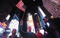 New Yorker Frank Franchi (C) waves an American flag as people celebrate in Times Square after the death of accused 9-11 mastermind Osama bin Laden was announced by U.S. President Barack Obama May 2, 2011 in New York City.