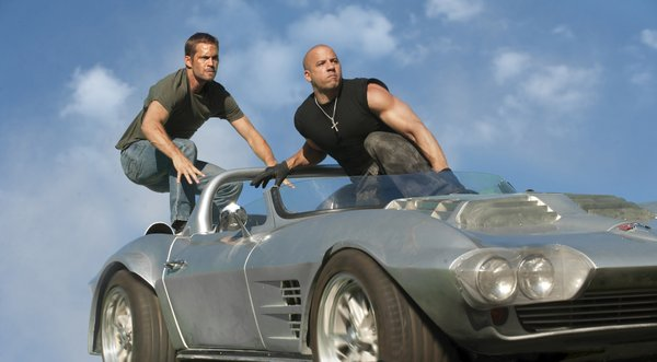 "Leap of faith... Paul Walker and Vin Diesel off the cliff in ""Fast Five."""