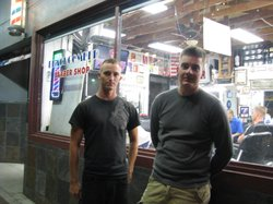 Andrew Bell and Jerry Dixon, Marines based at Camp Pendleton, stand outside a barber's chop in Oceanside as they talk about their reactions to Bin Laden's death.