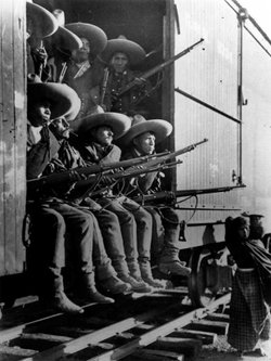 Rurales pose with their rifles.