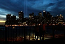 People look at the 'Tribute in Light' in downtown Manhattan from the Promenade in Brooklyn Heights on September 11, 2010 in the Brooklyn borough of New York City.