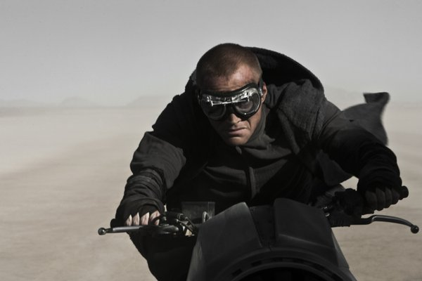 "Paul Bettany and some of the other priests ride these cool retro futuristic cycles in ""Priest."""