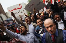 Supporters of the people of Yemen chant during a demonstration calling for th...