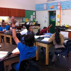 Mann Middle School seventh graders wait to be called on while working on proj...