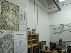 Drawings by Barrio Azteca gang members hang in the office of Officer Raul Rey...