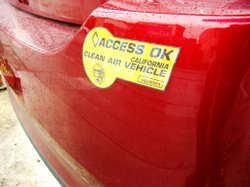 Some car makers say California's HOV stickers should not longer be doled out to hybrid cars.