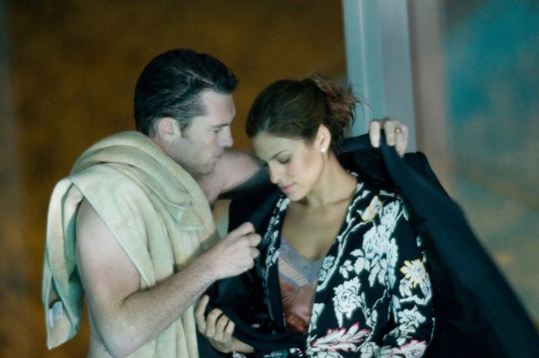 "Sam Worthington and Eva Mendes are colleagues tempted by each other in ""Last Night."""