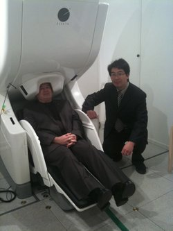 Mingxiong Huang PHD with his research subject, Col. G.I. Wilson, in the MEG brain scanner at UCSD's radiology lab. May 11th 2011
