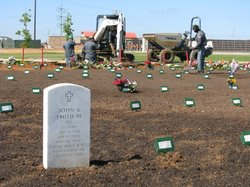 The first white headstone at the new National Cemetery at MCAS Miramar May 26...