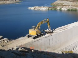The San Diego County Water Authority has been upgrading its existing water storage facilities in an effort to decrease reliance on the Metropolitan Water Authority.  This photo from November 2009 shows  construction at the San Vicente Dam to remove the right crest of the dam to increase the size of the reservoir.