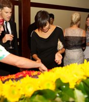 KPBS Gala guests helped create a living peace symbol.  Green Fresh Florals' Justin Sokol directed the effort.
