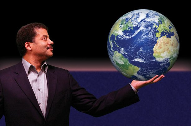 "Promotional photo of renowned astrophysicist Neil deGrasse Tyson, host of ""NOVA scienceNOW"" with the Earth in his hands"