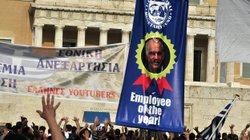 Protesters demonstrate in front of the Greek Parliament in Athens on Wednesda...