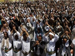 Anti-government protesters attend a rally to demand the ouster of Yemen's Pre...