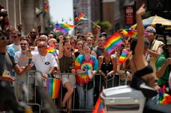 People wave flags during the 2011 NYC LGBT Pride March on the streets of Manh...