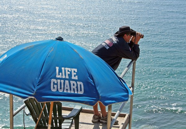 A San Diego lifeguard working near the cliffs at Torrey Pines.