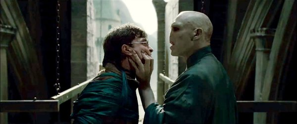 Daniel Radcliffe and Ralph Fiennes face off as Harry Potter and lord Voldemort.