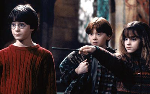 "Daniel Radcliffe, Rupert Grint, and Emma Watson in the first film, ""Harry Potter and the Sorcerer's Stone."""