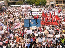 A handout picture from the official Syrian Arab News Agency (SANA) shows pro-regime Syrians rallying in Aleppo, Syria's second-largest city, on July 10, 2011 against foreign interference in their country.