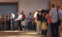 People stand in line as they attend the HOPE NOW event which helps homeowners speak to their bank personnel to go over their mortgage issue at the Westin Diplomat Resort & Spa on July 11, 2011 in Hollywood, Florida.